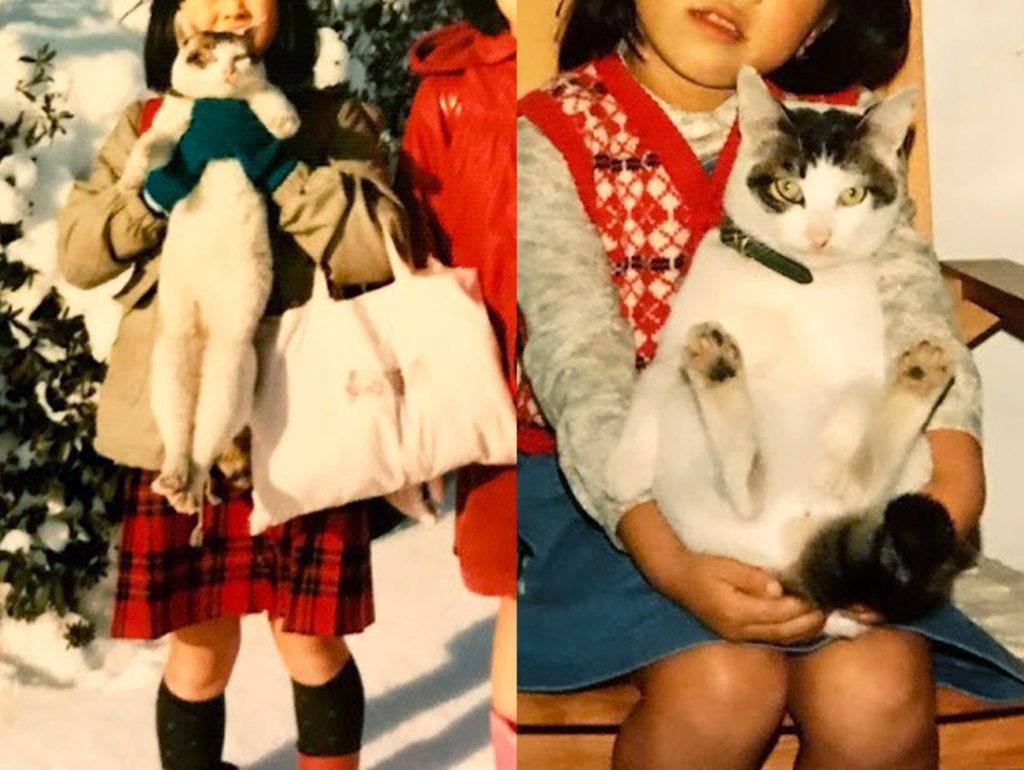 抱っこされておとなしくしている猫と姉妹