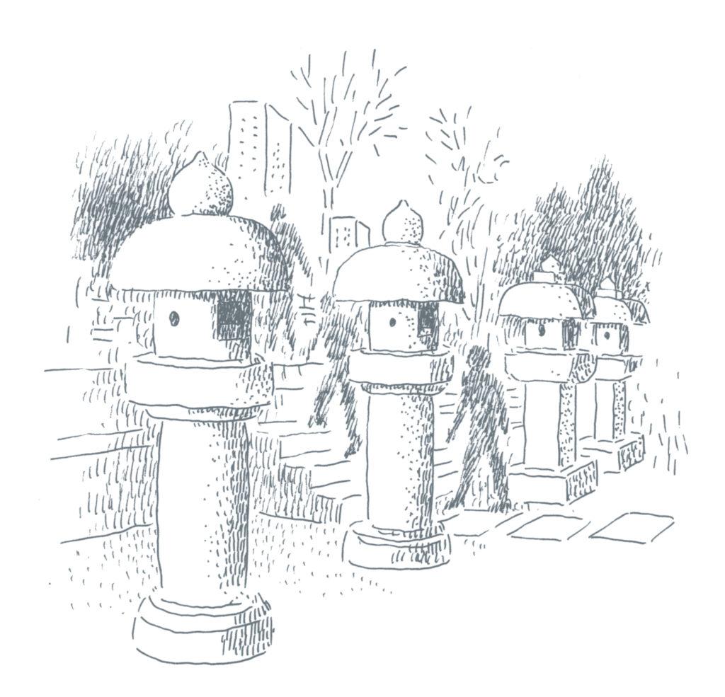 石灯籠が並ぶ墓地